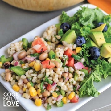 Barley salad with black eyed peas on a white plate