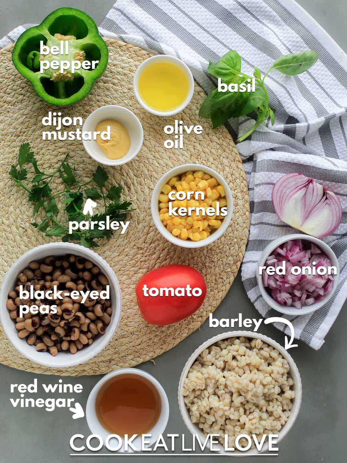 Ingredients to make barley salad on the table with text labels