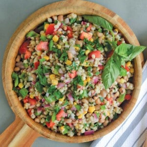 Wooden bowl filled with barley salad