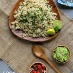 Brown wooden plate with coconut lime brown rice on the table