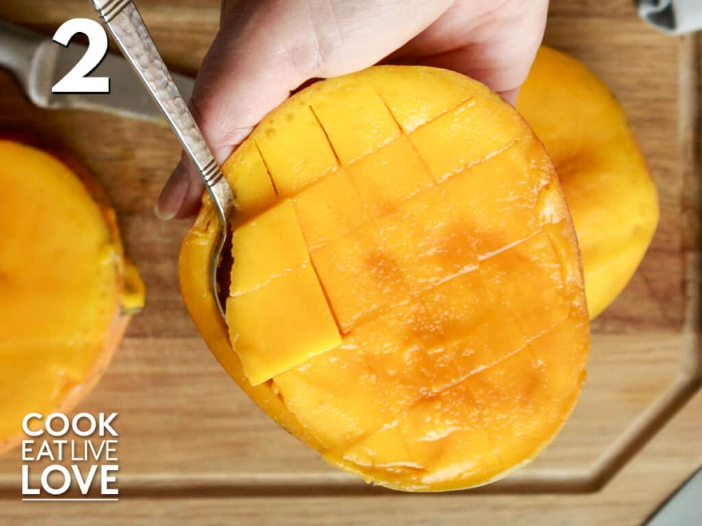 Scooping the mango from the peel