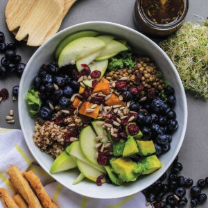 Nourish bowl on table with crackers and breadsticks