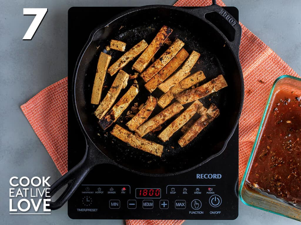 Tofu cooking in a skillet
