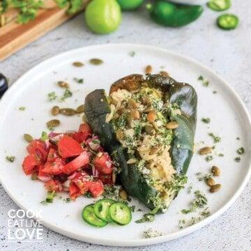 Vegetarian stuffed poblano pepper on a white plate
