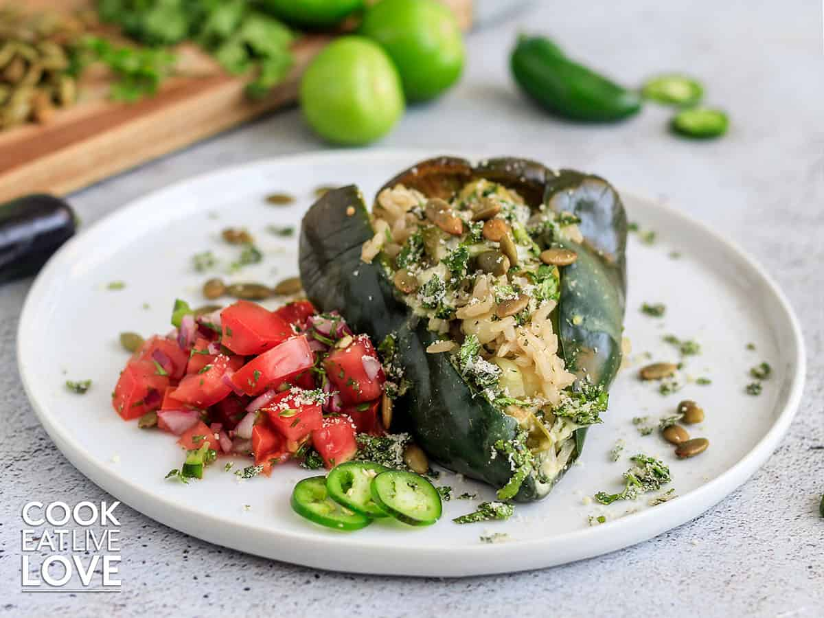 Stuffed poblano served up on a plate