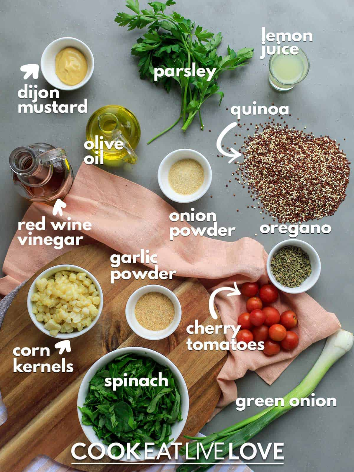 Ingredients to make zesty quinoa salad on a table with text labels
