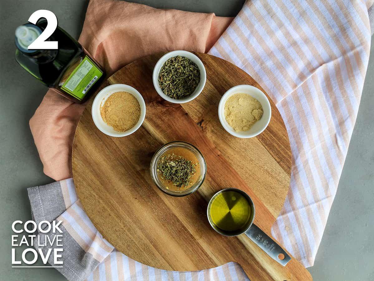 Ingredients to make lemon dijon vinaigrette in a little jar.