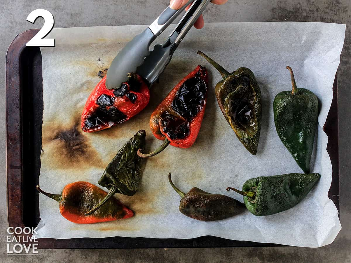 Turning poblano peppers over with tongs