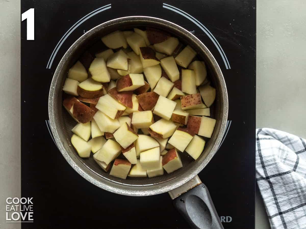 Potatoes in pot of water