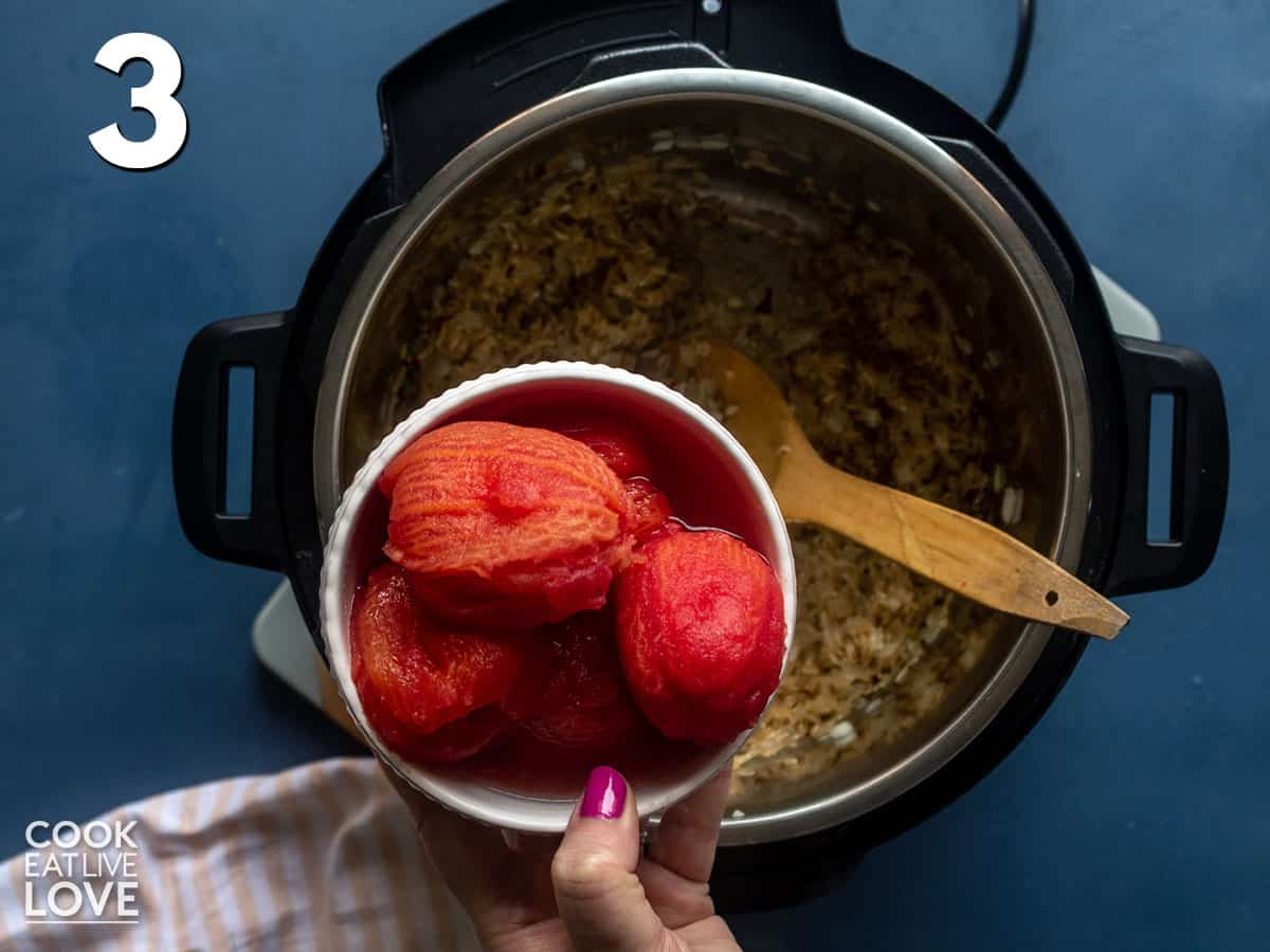 Adding tomatoes to the Instant Pot