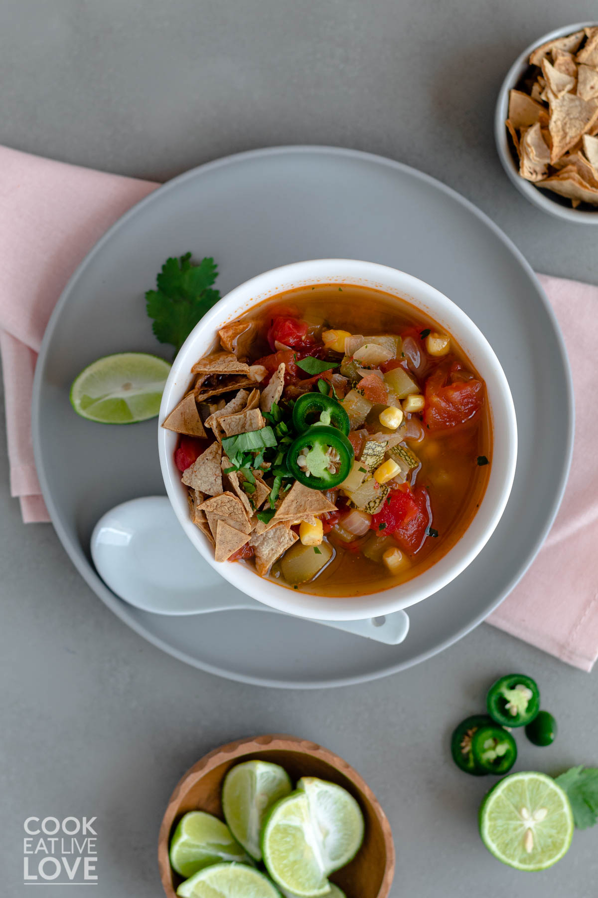 Bowl of Instant pot taco soup on a plate with spoon