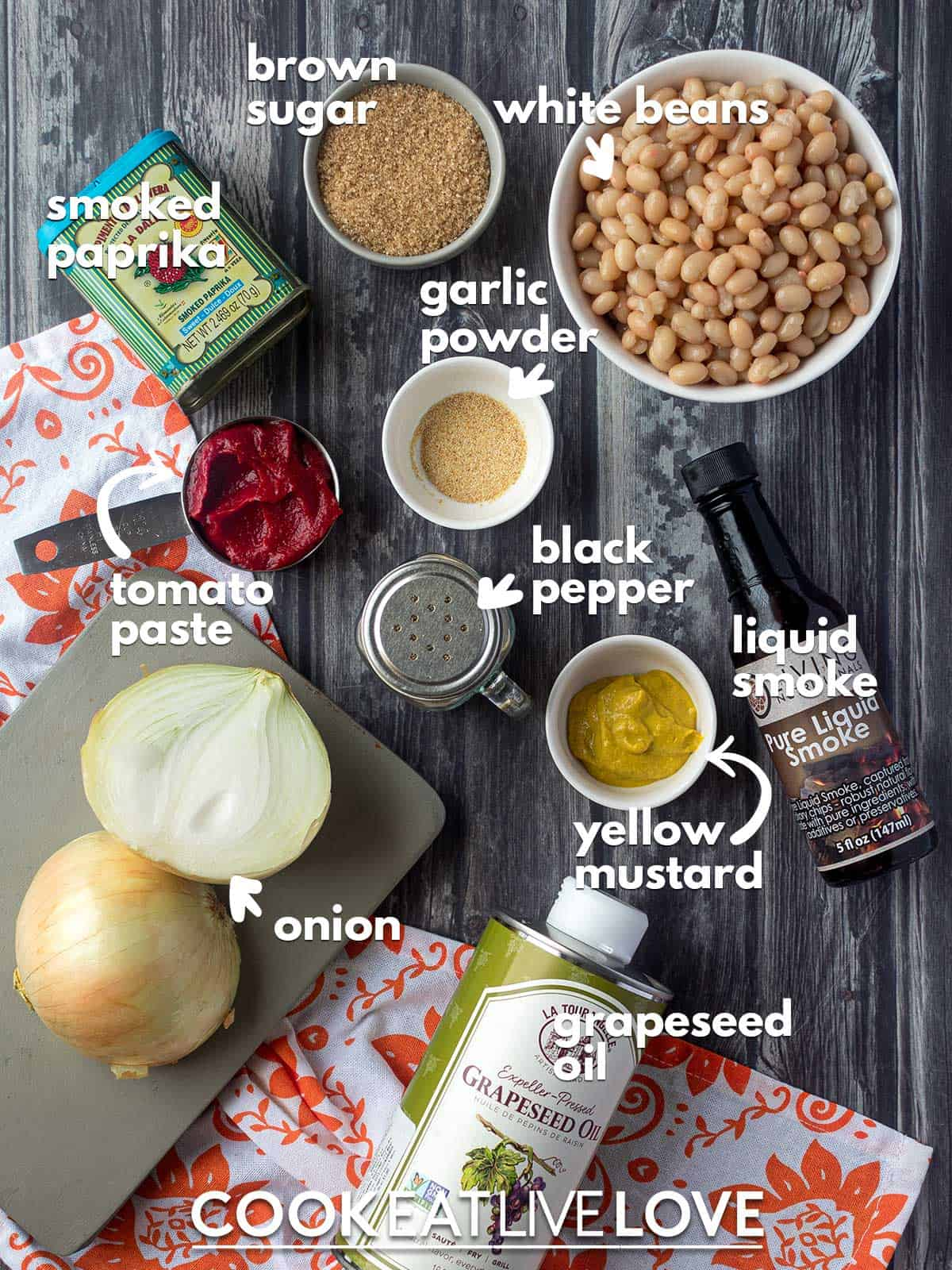 Ingredients to make vegan baked beans on the table with text labels.