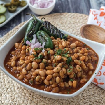 Vegan baked beans in a white serving bowl