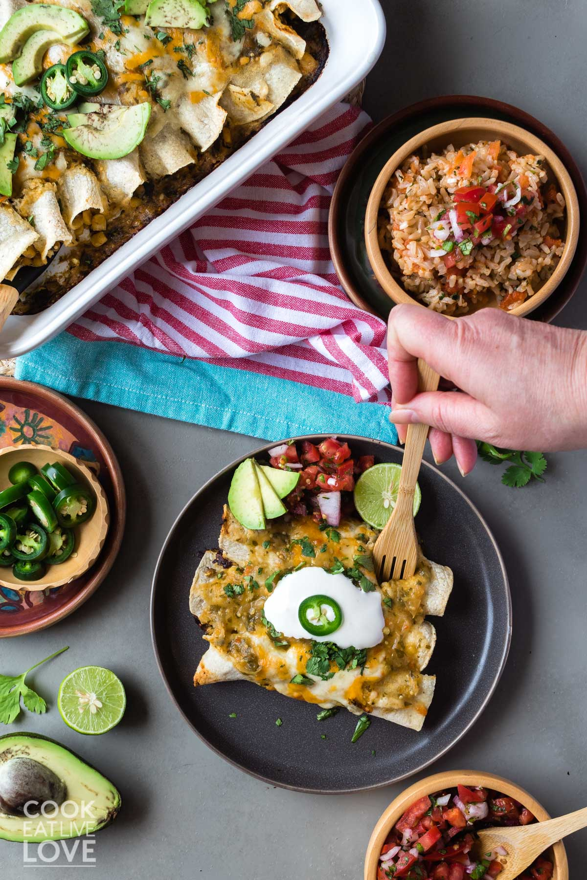 Vegetarian green enchiladas in a casserole dish and served up on plate