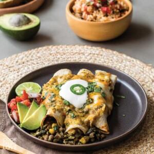Vegetarian lentil enchiladas are served on a plate