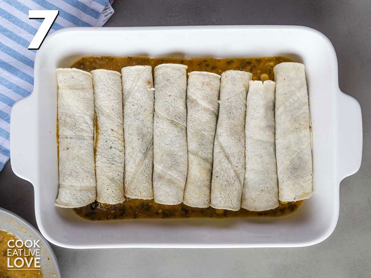 All the enchiladas are rolled and in the baking dish.
