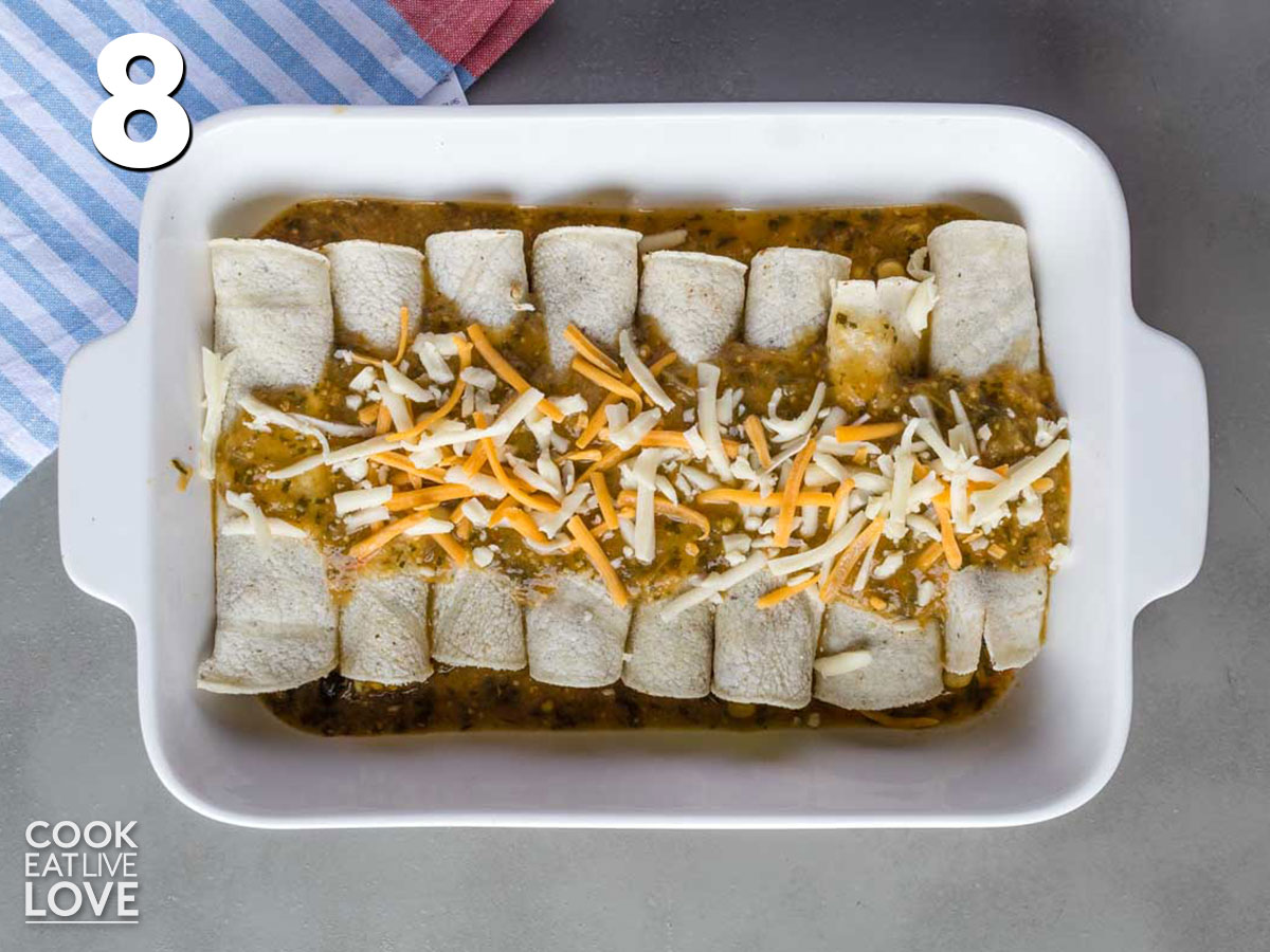 Enchiladas are topped with green enchilada sauce, cheese before baked in the oven