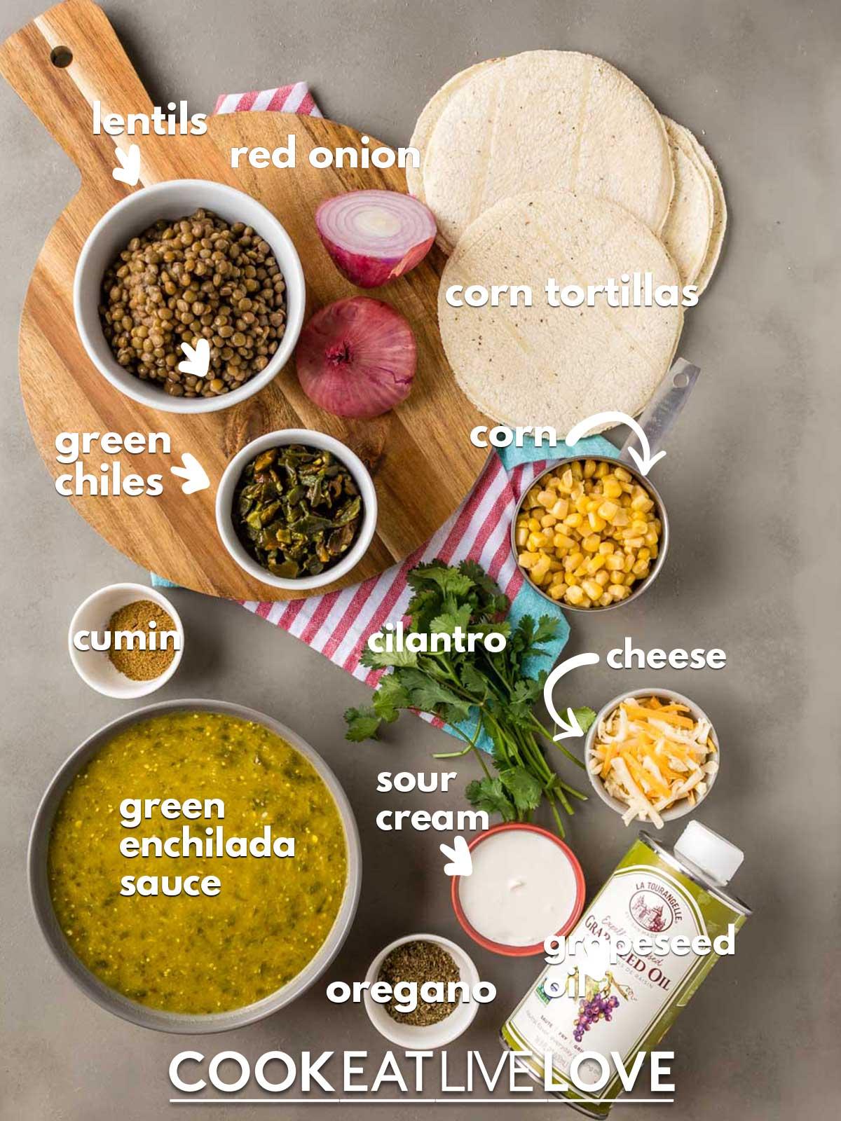 Ingredients to make vegetarian green enchiladas on the table